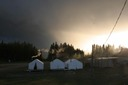 canvas tents and a moody sky